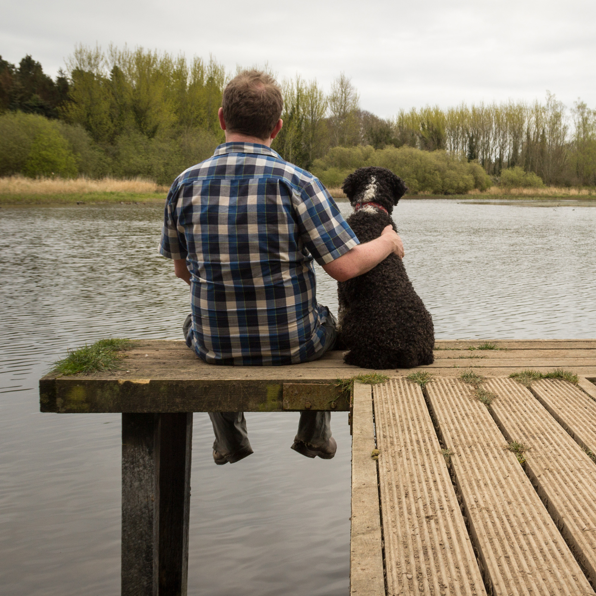 Man and dog on a dock