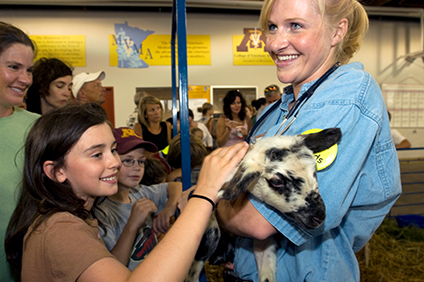 Student holding a goat at the state fair