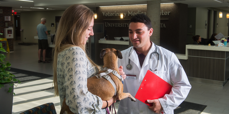 DVM student with client and her pet
