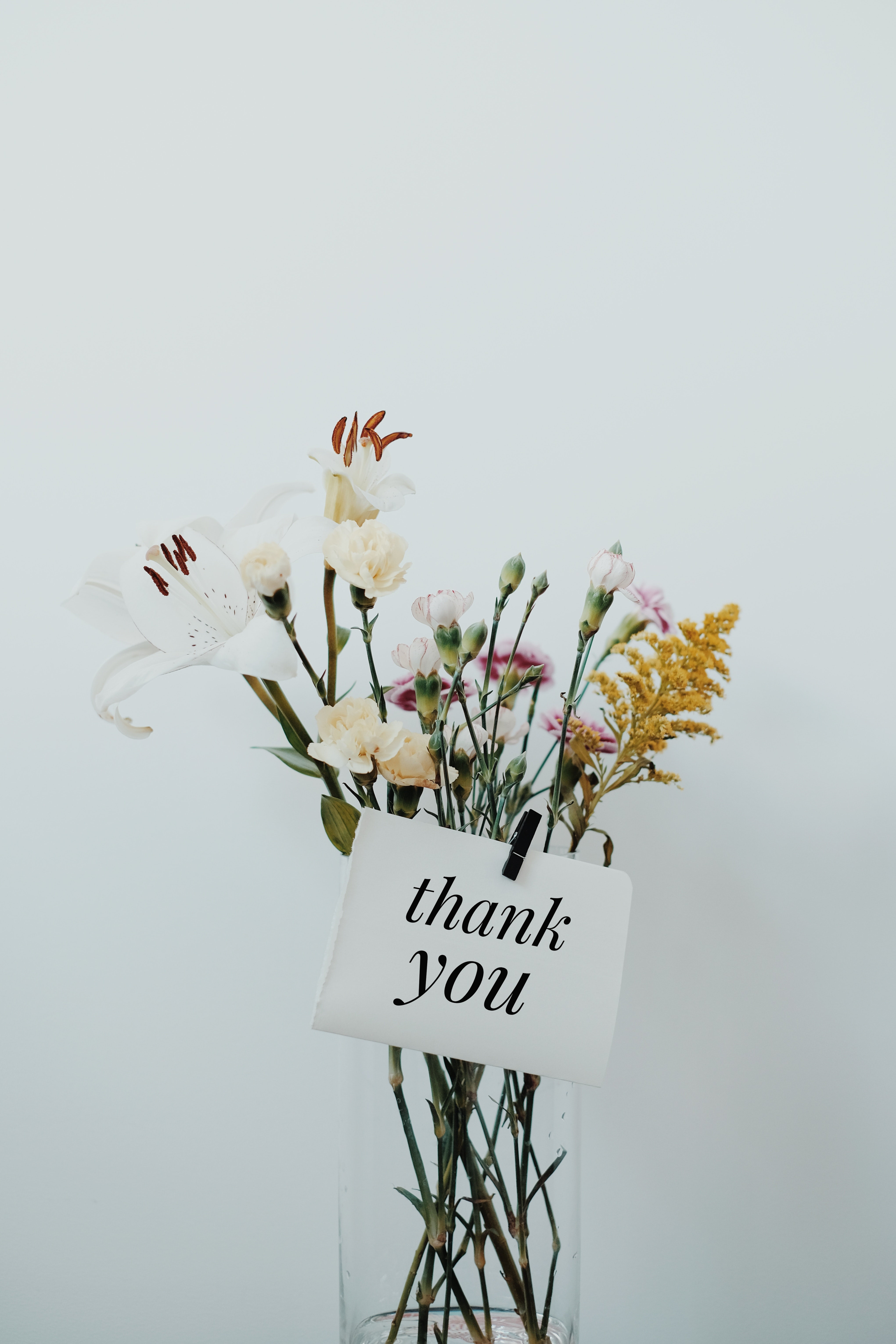 wildflowers in vase with thank you note